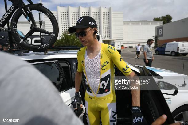 Great Britain's Christopher Froome wearing the overall leader's yellow jersey arrives at the Velodrome stadium prior to taking the start of a 225 km...