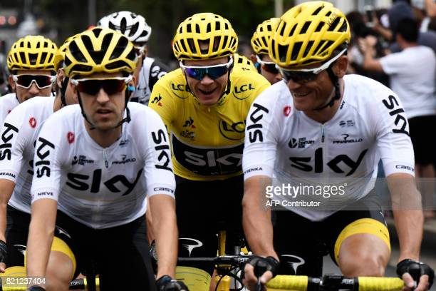 Great Britain's Christopher Froome wearing the overall leader's yellow jersey and his teammates of the Great Britain's Sky cycling team Great...