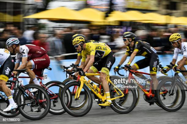 Great Britain's Christopher Froome wearing the overall leader's yellow jersey rides during the 103 km twentyfirst and last stage of the 104th edition...