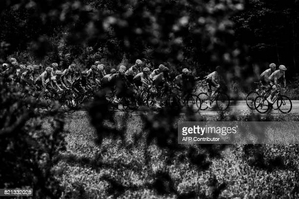 Great Britain's Christopher Froome wearing the overall leader's yellow jersey rides in the pack during the 183 km seventeenth stage of the 104th...