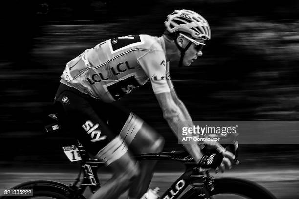 Great Britain's Christopher Froome wearing the overall leader's yellow jersey rides during the 2225 km nineteenth stage of the 104th edition of the...
