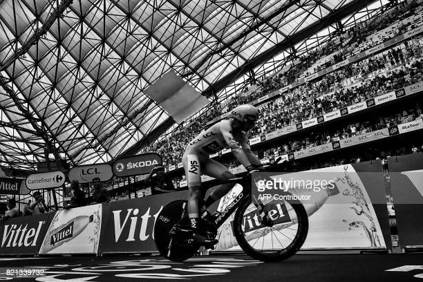 Great Britain's Christopher Froome wearing the overall leader's yellow jersey rides after crossing the finish line at the Velodrome stadium at the...