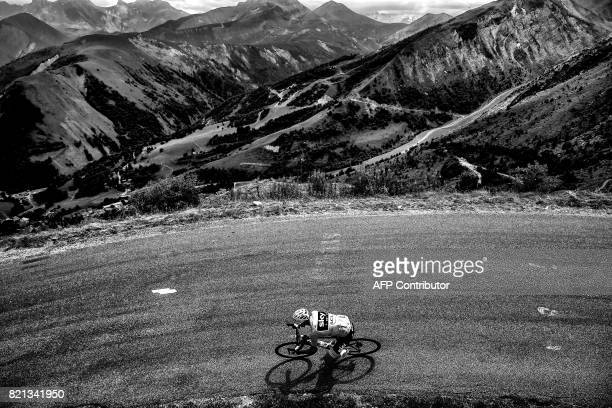 Great Britain's Christopher Froome wearing the overall leader's yellow jersey rides during the 183 km seventeenth stage of the 104th edition of the...