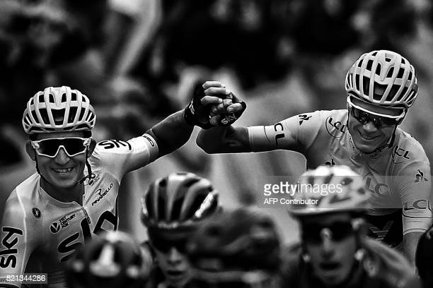 Great Britain's Christopher Froome wearing the overall leader's yellow jersey wins the Tour de France 2017 as he crosses the finish line with his...