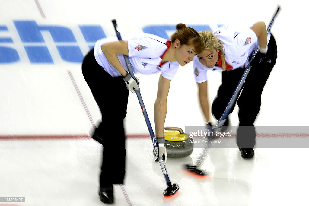 Great Britain's Claire Hamilton (left) and <a gi-track='captionPersonalityLinkClicked' href=/galleries/search?phrase=Anna+Sloan&family=editorial&specificpeople=7577274 ng-click='$event.stopPropagation()'>Anna Sloan</a> sweep during a women's curling qualifier against Canada at the Ice Cube Curling Center. Sochi 2014 Winter Olympics on Wednesday, February 12, 2014.