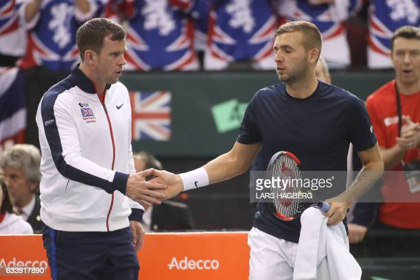 Great Britain's coach Leon Smith wishes Daniel Evans good luck against Vasek Pospisil of Canada during the third day of Davis Cup first round between...