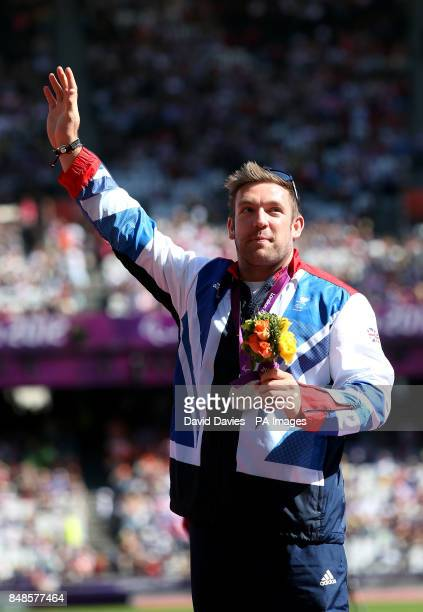 Great Britain's Dan Greaves celebrates his silver medal in the Men's Discus Throw T44 category in the Olympic Stadium London