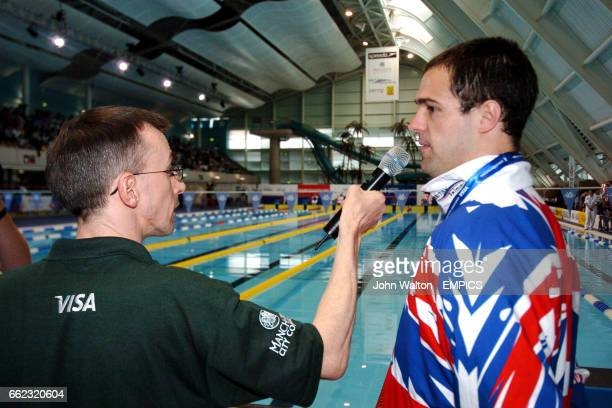 Great Britain's David Roberts is interviewed after receiving his gold medal for the Mens S7 50m Freestyle