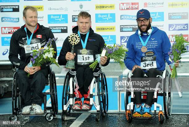 Great Britain's David Weir celebrates winning the Men's Elite Wheelchair race of the 2013 Great North Run ahead of Canada's Josh Cassidy who came...