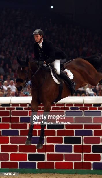Great Britain's Derek Morton riding Teddy Bear II competes in the Puissance on day four of the Horse of the Year show at the NEC arena in Birmingham