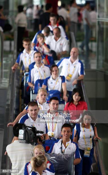 Great Britain's diver Tom Daley and team mates are greeted by the media as they arrive at Beijing airport in China