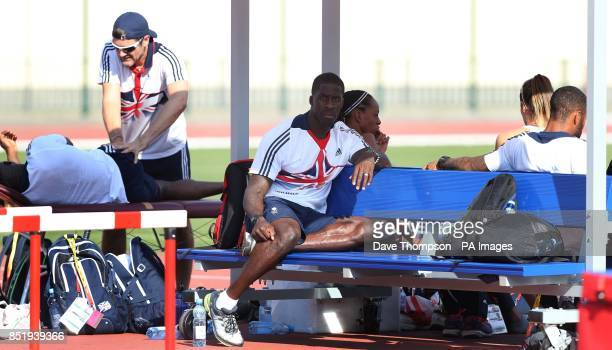 Great Britain's Dwain Chambers sits with his teammates during an open training session at the Northern Sports Arena Moscow