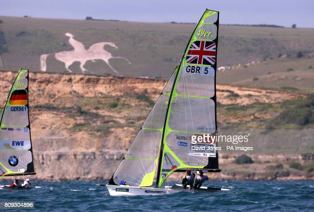 Great Britain's Dylan Fletcher and Alain Sign sail their 49er class beneath the Osmington White Horse during day four of the Skandia Sail for Gold...