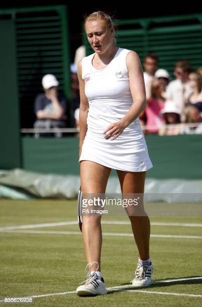 Great Britain's Elena Baltacha appears dejected during her match against Belgium's Kirsten Flipkens during the 2009 Wimbledon Championships at the...