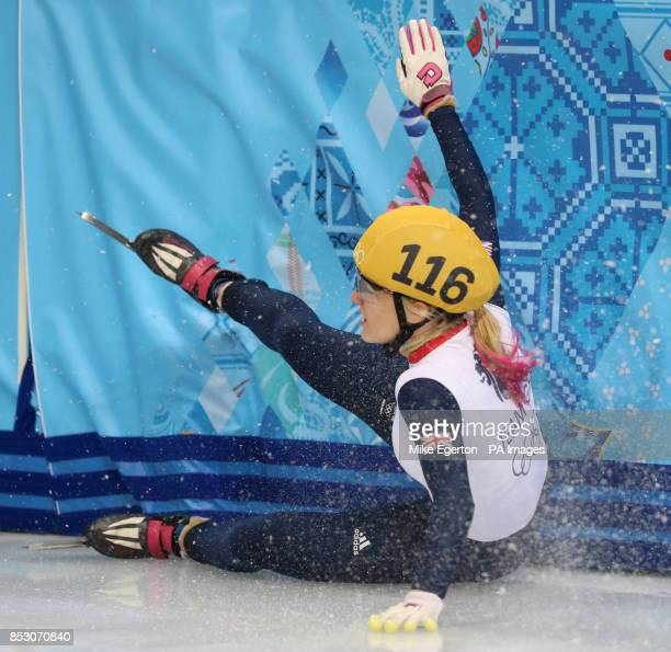 Great Britain's Elise Christie crashes out in the semi final of the Ladies 1000m short track speed skating at the Iceberg Skating palace during the...