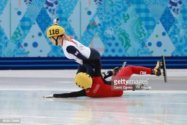 Great Britain's Elise Christie crashes with China's Li Jianrou out in her1000m Short Track Semi Final at the Iceberg Skating Palace during the 2014...