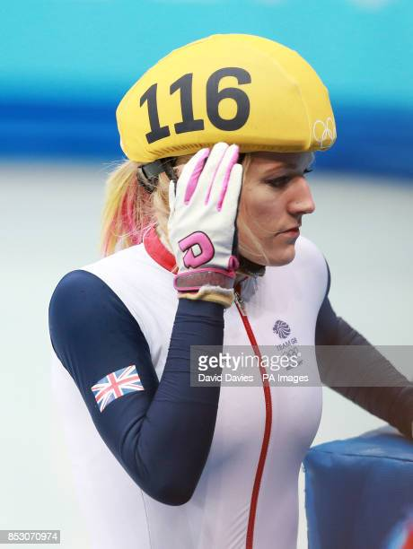 Great Britain's Elise Christie reacts after crashing out in her1000m Short Track Semi Final at the Iceberg Skating Palace during the 2014 Sochi...