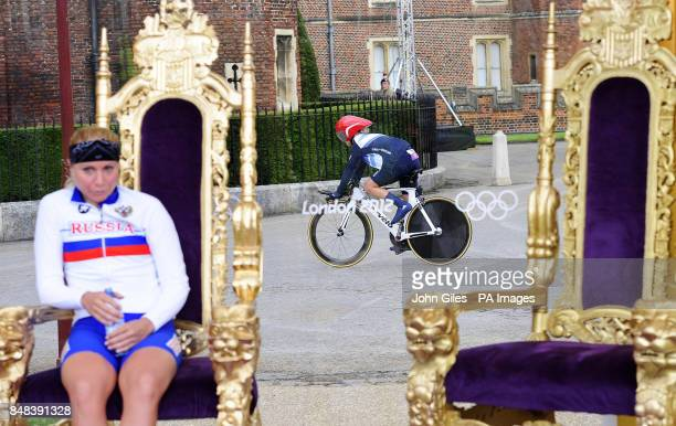 Great Britain's Emma Pooley rides past the thrones after completing the Women's Individual Time Trial on day five of the London Olympic Games at...