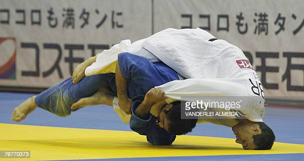 Great Britain's Euan Burton fights with Italy's Giuseppe Maddaloni during the men's 81kg category at the 25th World Judo Championship in Rio de...