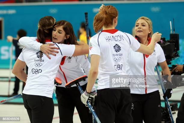 Great Britain's Eve Muirhead celebrates with Vicki Adams and her team mates after victory over Russia in the women's curling during the 2014 Sochi...