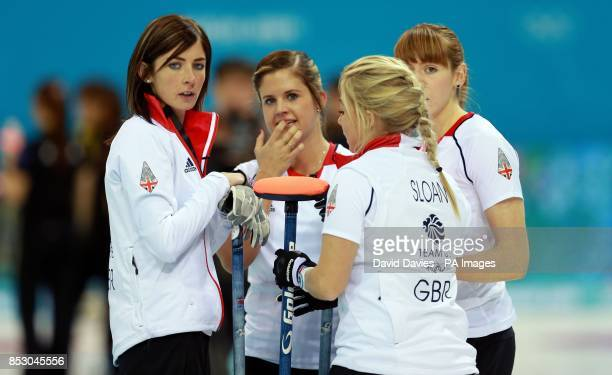 Great Britain's Eve Muirhead discusses tactics with her team mates in the women's curling during the 2014 Sochi Olympic Games in Sochi Russia