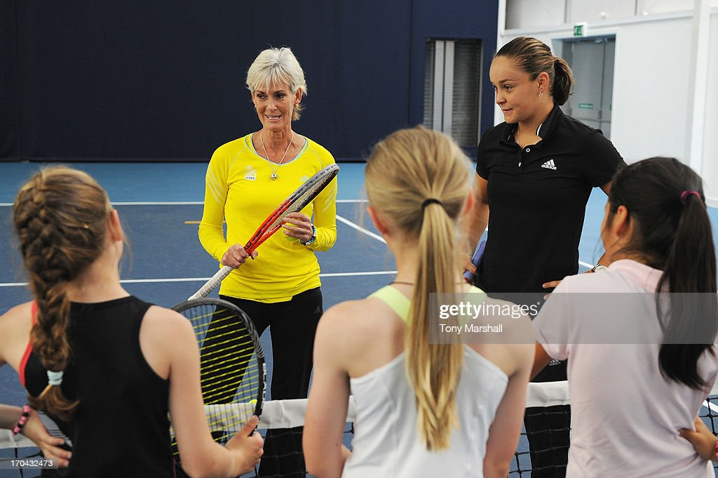 Great Britain's Fed Cup captain Judy Murray and Ashleigh Barty of Australia (R) take a training session with the National Under 12 High Performance players during day five of the AEGON Classic tennis tournament at Edgbaston Priory Club on June 13, 2013 in Birmingham, England.