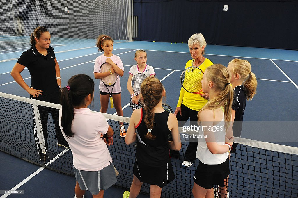 Great Britain's Fed Cup captain Judy Murray and Ashleigh Barty (L) of Australia take a training session with the National Under 12 High Performance players during day five of the AEGON Classic tennis tournament at Edgbaston Priory Club on June 13, 2013 in Birmingham, England.