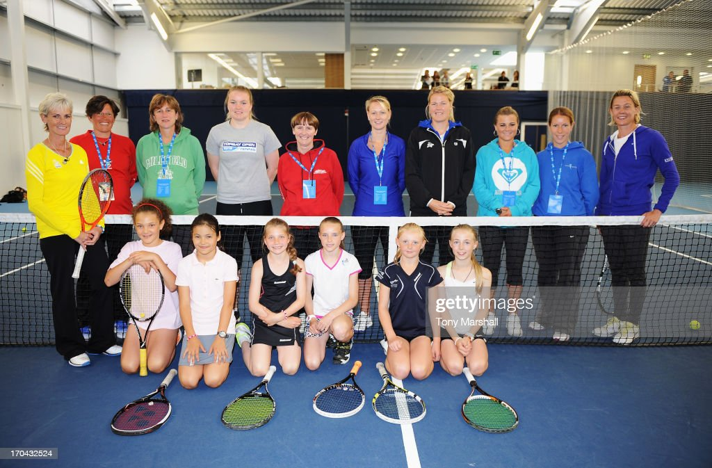 Great Britain's Fed Cup captain Judy Murray (L) poses with fellow coaches and members of the National Under 12 High Performance centre during day five of the AEGON Classic tennis tournament at Edgbaston Priory Club on June 13, 2013 in Birmingham, England.