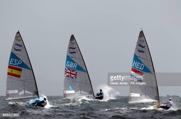 Great Britain's Finn sailor Ben Ainslie is followed from the windward mark by Spain's Rafael Trujillo Villar and Netherland's PieterJan Postma during...