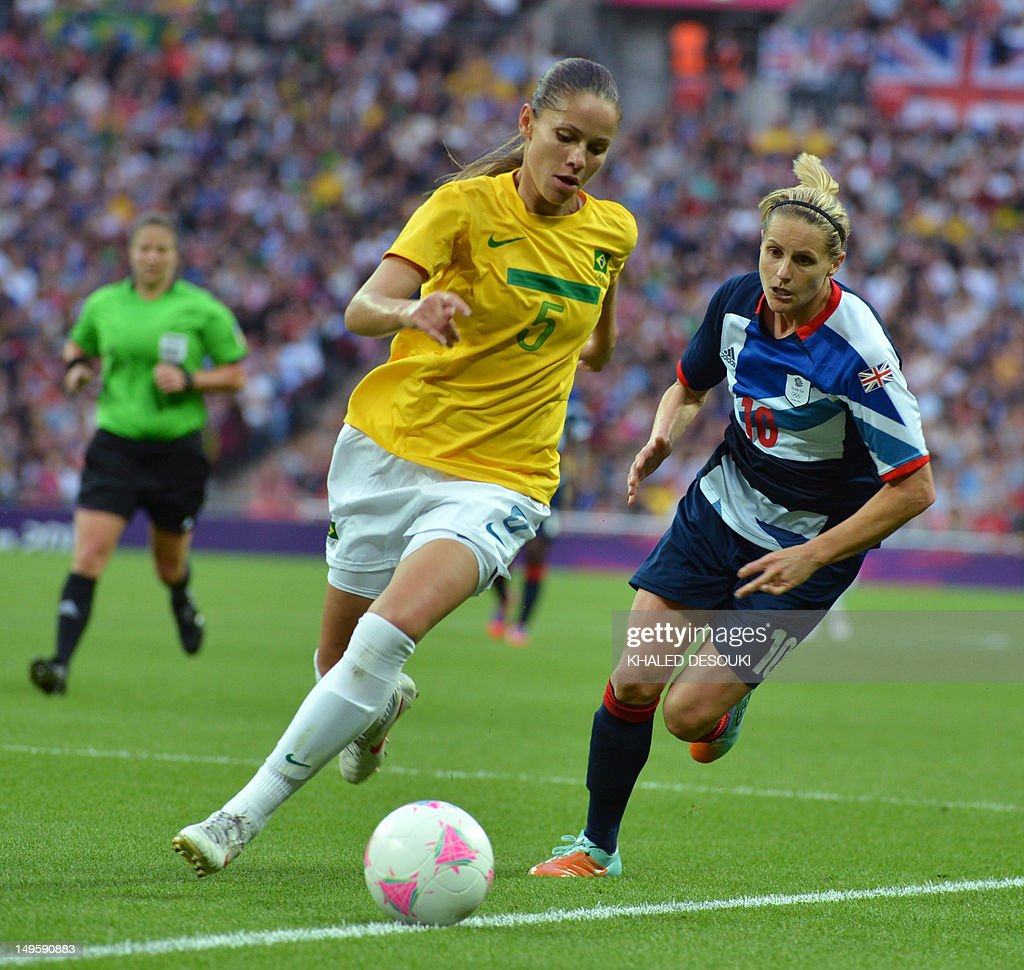 Great Britain's forward Kelly Smith vies with Brazil's defender Erika during their women's football match at the Wembley Stadium in London on July 31...