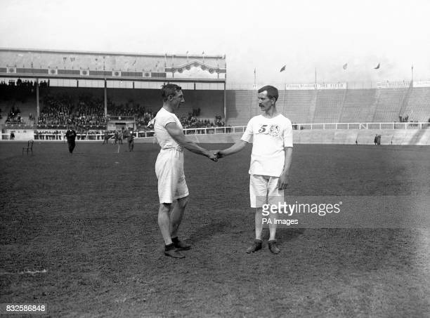Great Britain's George Larner shakes hands with compatriot Ernest Webb gold and silver medallists respectively in both the 3500m Walk and the 10 Mile...