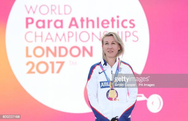 Great Britain's Georgina Hermitage with her gold medal after the Women's 400m T37 Final during day eight of the 2017 World Para Athletics...