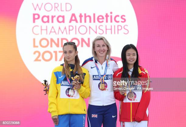 Great Britain's Georgina Hermitage with her gold medal with Ukraine's Natalia Kobzar and China's Fenfen Jiang after the Women's 400m T37 Final during...