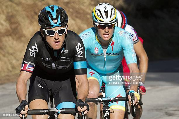 Great Britain's Geraint Thomas Denmark's Jakob Fuglsang and Slovakia's Simon Spilak ride in a breakaway during the fourth stage of the 73rd edition...