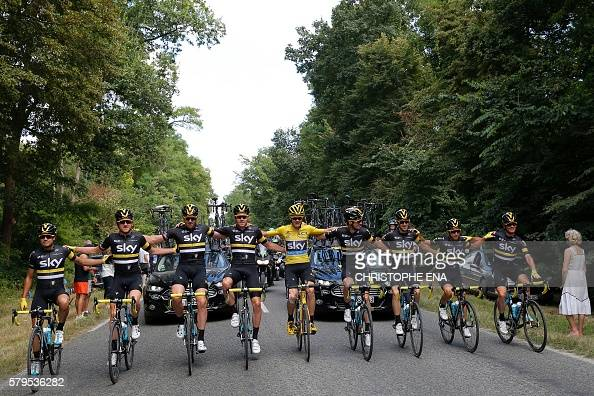 Great Britain's Geraint Thomas Great Britain's Ian Stannard Great Britain's Luke Rowe Great Britain's Christopher Froome wearing the overall leader's...