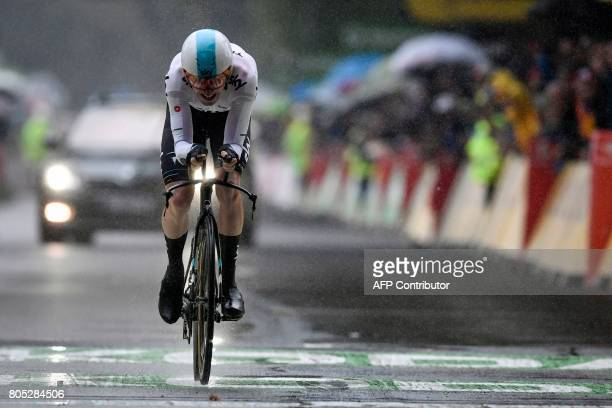 Great Britain's Geraint Thomas reacts as he crosses the finish line during a 14 km individual timetrial the first stage of the 104th edition of the...