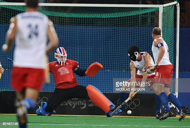 Great Britain's goalkeeper Alistair McGregor blocks a shot from Australia during their men's preliminary field hockey match at the Olympic Green...