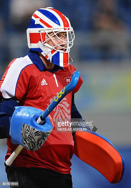 Great Britain's goalkeeper Alistair McGregor watches the Australian attack during their men's preliminary field hockey match at the Olympic Green...