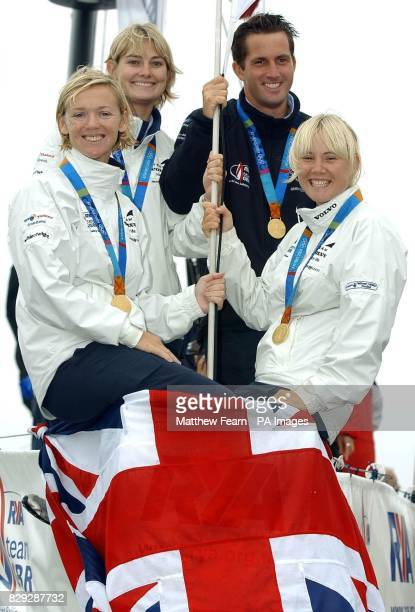 Great Britain's gold medal winning Olympic sailors Shirley Robertson Sarah Webb Ben Ainslie and Sarah Ayton on the bow of an Open 60 yacht after...