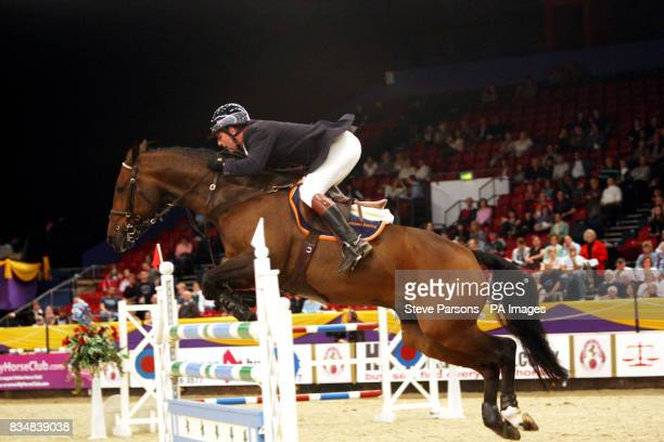 Great Britain's Guy Williams riding Torinto Van De Middelstone competes in the Thomas Bates and Son Classic as the International Showjumping begins...