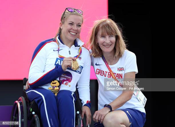 Great Britain's Hannah Cockroft with her gold medal and coach Jenni Banks after the Women's 400m T34 Final during day eight of the 2017 World Para...
