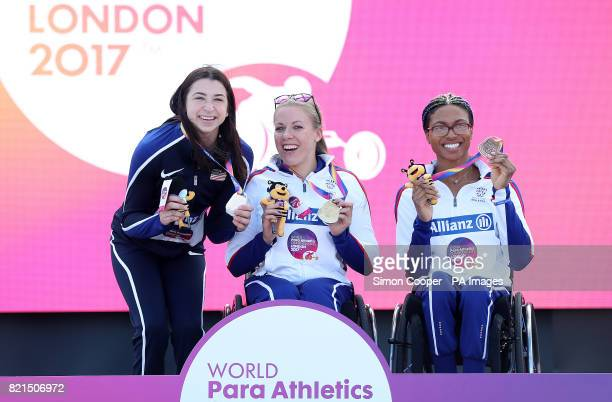 Great Britain's Hannah Cockroft with her gold medal and compatriot Kare Adenegan with her bronze with USA's Alexa Halko after the Women's 400m T34...