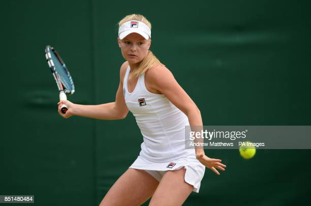 Great Britain's Harriet Dart in action against Croatia's Ana Konjuh in their Girl's Singles match during day eight of the Wimbledon Championships at...