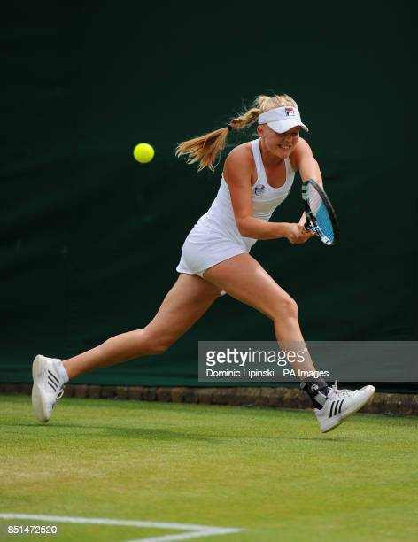 Great Britain's Harriet Dart in action against Latvia's Jelena Ostapenko during day seven of the Wimbledon Championships at The All England Lawn...