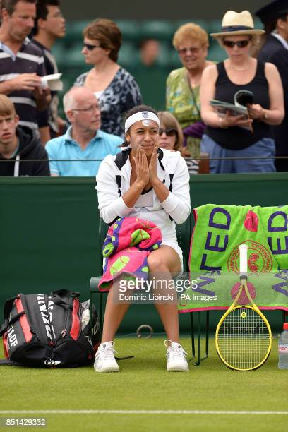 Great Britain's Heather Watson applies sun cream to her face ahead of her Ladies doubles match during day Three of the Wimbledon Championships at The...