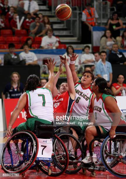 Great Britain's Helen Freeman shoots over Mexico's Floralia Estrada Rocio Torres and Lucia Vazquez during the Wheelchair Basketball match at the...