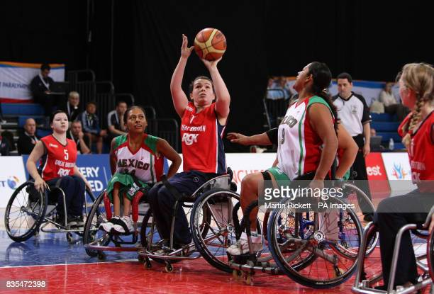 Great Britain's Helen Freeman shoots over Mexico's Lucia Vazquez and Brisia Hernandez during the Wheelchair Basketball match at the Manchester...