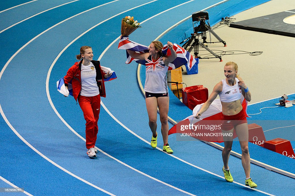 Great Britain's Holly Bleasdale (C) celebrates after wining the women's Pole Vault final next to 2nd placed Poland's Anna Rogowska (R) and 3rd Russia's Anzhelika Sidorova (L) at the European Indoor athletics Championships in Gothenburg, Sweden, on March 2, 2013.