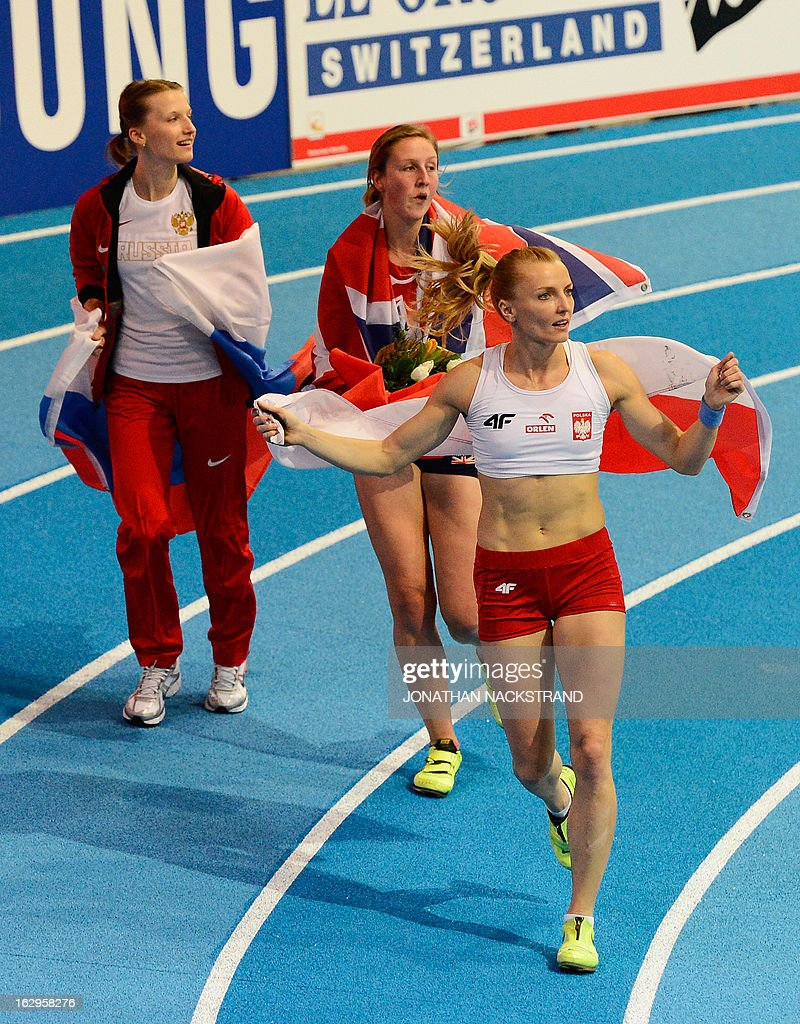 Great Britain's Holly Bleasdale (C) celebrates after wining the women's Pole Vault final with 2nd placed Poland's Anna Rogowska (R) and 3rd Russia's Anzhelika Sidorova (L) at the European Indoor athletics Championships in Gothenburg, Sweden, on March 2, 2013.