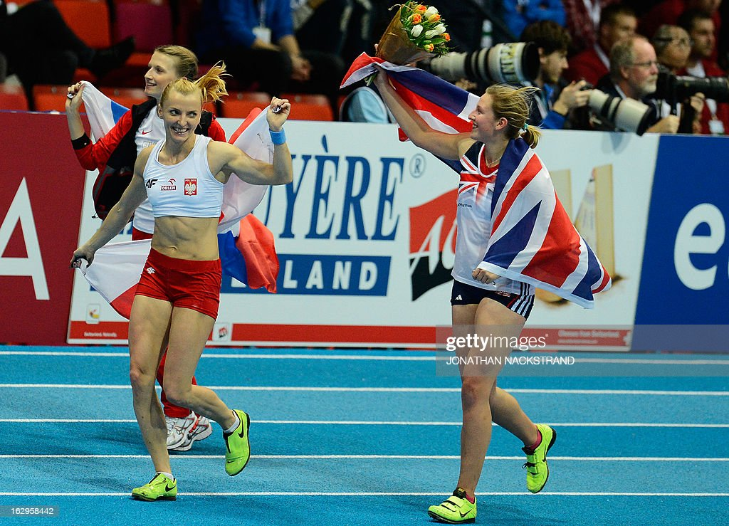 Great Britain's Holly Bleasdale (R) celebrates after wining the women's Pole Vault final with 2nd placed Poland's Anna Rogowska (C) and 3rd Russia's Anzhelika Sidorova (L) at the European Indoor athletics Championships in Gothenburg, Sweden, on March 2, 2013.